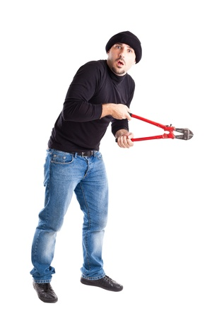 a burglar or a thief holding big wire cutters