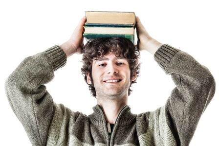 an handsome student with some books isolated over a white background photo