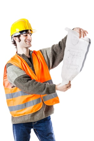 an handsome architect or engineer or foreman wearing a hard hat and reflective vest and carrying some construction plans. isolated on white photo