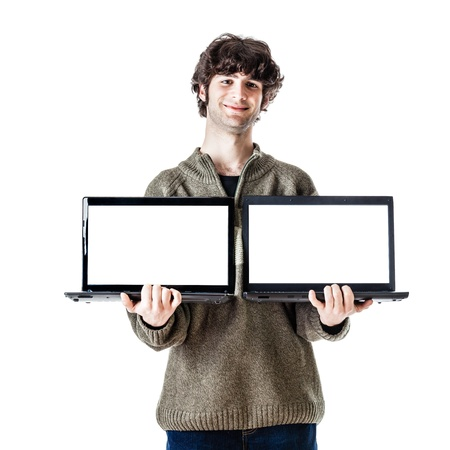 an handsome guy, maybe a student, in casual clothing showing two laptops with blank monitors Stock Photo