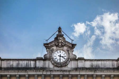 detail of the facade of a european railway station with an old clock Stock Photo - 21385595