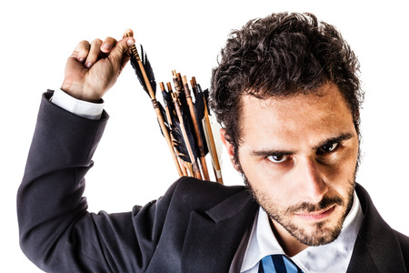 an elegant young businessman extracting an arrow from the quiver on his back
