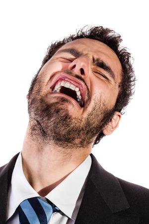 Retrato de un apuesto hombre de negocios haciendo una cara aislada sobre un fondo blanco Foto de archivo - 23300239