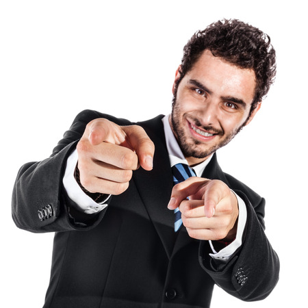 beckon: a cool and handsome businessman pointing at you with both index fingers (focus on fingers)