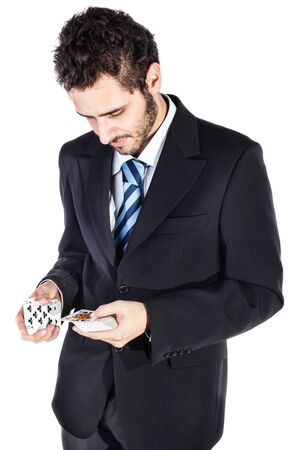 an elegant young businessman holding a deck of playing cards isolated over a white background photo