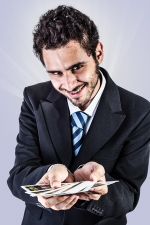 an elegant young businessman holding a deck of playing cards photo