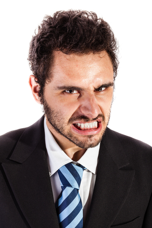 vengeful: portrait of an handsome businessman making a face isolated over a white background Stock Photo