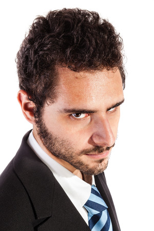dictatorial: portrait of an handsome businessman making a face isolated over a white background Stock Photo