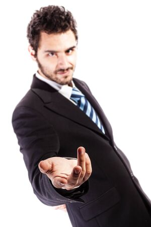 harnessing: a young and handsome businessman in an evil pose isolated over a white background