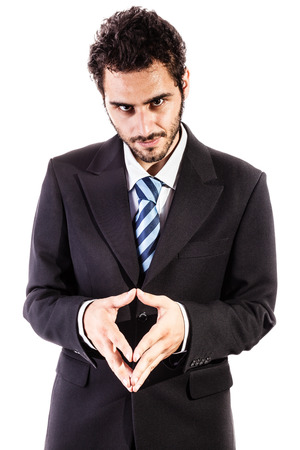a young and handsome businessman in an evil pose isolated over a white background