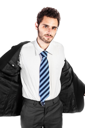 fiercely: a young and handsome businessman taking off his jacket over a white background