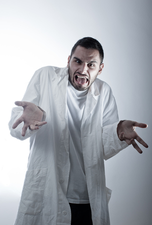 A young researcher wearing a labcoat shocked or disgusted