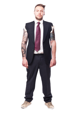 Businessman in a suit with no sleeves and tattoo on his arms Stockfoto