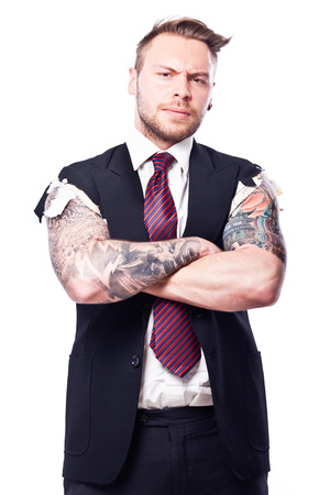 Businessman in a suit with no sleeves and tattoo on his arms Stock Photo
