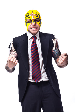 businessman in a suit with no sleeves and tattoo on his arms wearing a wrestling mask