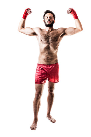 a very muscular young boxer with red trunks and hand wraps isolated over white background Stock Photo - 23367340
