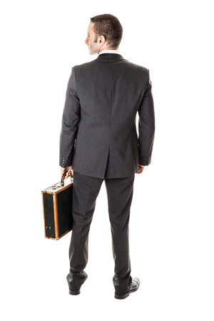an handsome businessman with a briefcase isolated over a white background photo