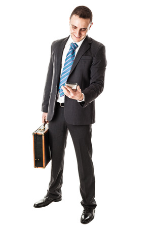 businessman waiting call: an handsome businessman with a smartphone isolated over a white background Stock Photo