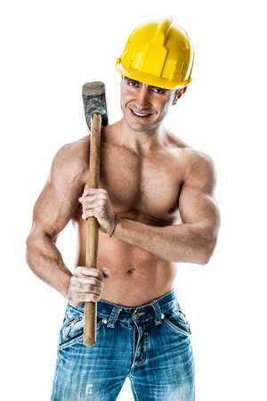a very muscular and handsome manual worker with a sludgehammer and a yellow helmet isolated over white Stock Photo - 23367674
