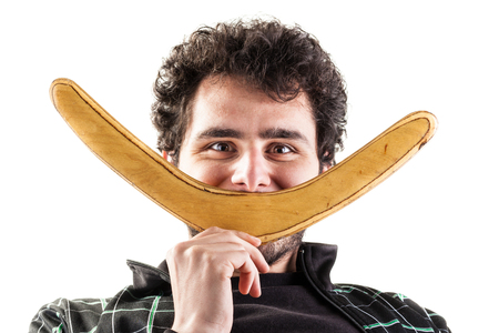 a young man with a boomerang smiling isolated over a white background