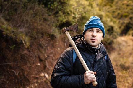 psychopath: a lumberjack or a psychopath holding a rusty hatchet Stock Photo