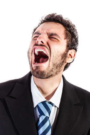 a young and handsome businessman in crying over a white background Stock Photo - 23423020