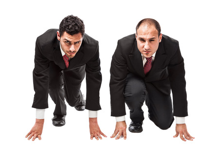 two competitive businessmen in starting position ready to run a race photo