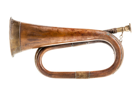 reveille: an old and rusty bugle isolated over a white background Stock Photo