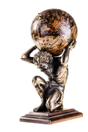 a sculpture of the mythic Atlas holding the world over a white background