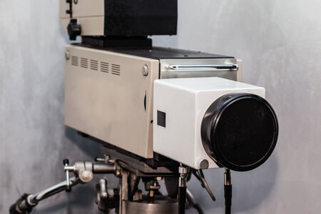 an obsolete analog tv studio camera on a tripod photo
