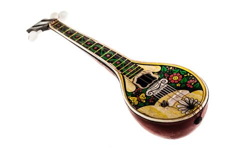 mandolino: una sporca giocattolo bouzouki isolato su uno sfondo bianco Archivio Fotografico