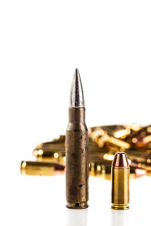 armament: a heap of 9mm pistol bullets isolated over a white background