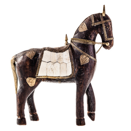 an ancient statuette depicting a horse isolated over a white background