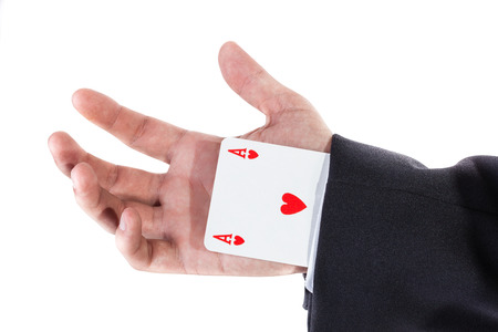 cheater: an elegant young businessman making card tricks with poker cards Stock Photo