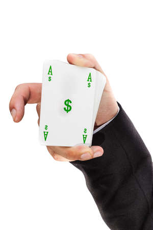 an elegant young businessman showing an ace in his hand photo