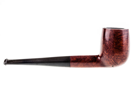 an old tobacco pipe isolated over a white background photo