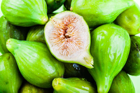 macro shot of a lot of green figs with a sliced one on top Stock Photo - 23394051