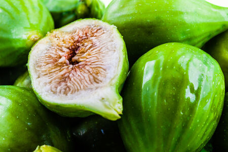 macro shot of a lot of green figs with a sliced one on top Stock Photo - 23394049