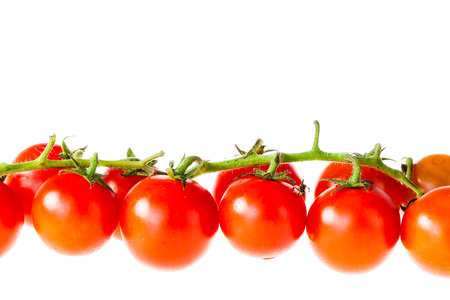 a branch of ripe cherry tomatoes isolated over a white background Stock Photo - 23394053