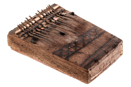 an african instrument named Mbira,  that consists of a wooden board with attached staggered metal keys Stock Photo - 23394093