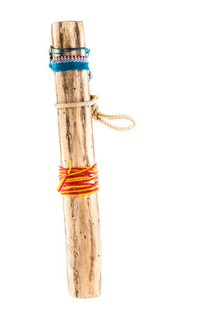 a rainstick, an instrument that is believed to have been invented by the Aztecs and was played in the belief it could bring about rainstorms. Rainsticks are usually made from cactus Stock Photo - 23394104