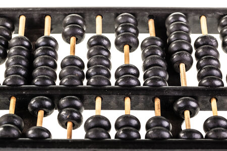 a traditional old black abacus isolated over a white background Stock Photo - 23394106