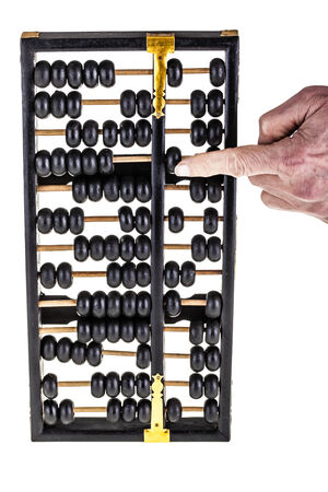 computations: a traditional old black abacus isolated over a white background