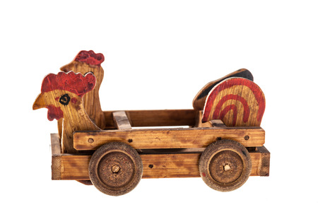 a wooden old toy car isolated over a white background Stock Photo - 23394108