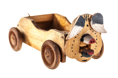 a wooden old toy car isolated over a white background Stock Photo - 23394113