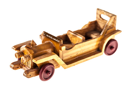 a wooden old toy car isolated over a white background Stock Photo - 23394111
