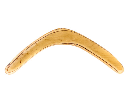 a simple wooden boomerang isolated over a white background Stock Photo - 23394118