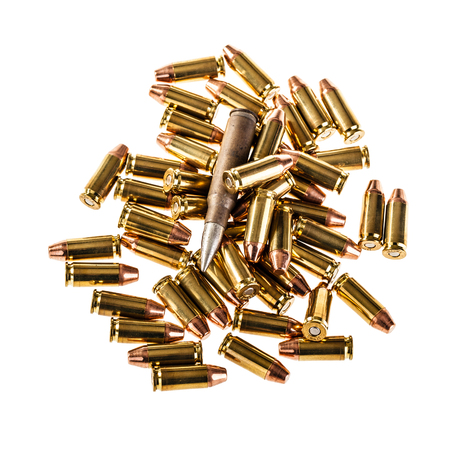 warheads: a heap of 9mm pistol bullets isolated over a white background