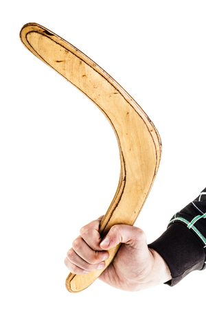 a traditional wooden australian boomerand isolated over a white background photo