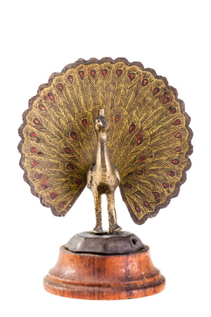 indian artifacts: a statuette depicting a peacock isolated over a white background